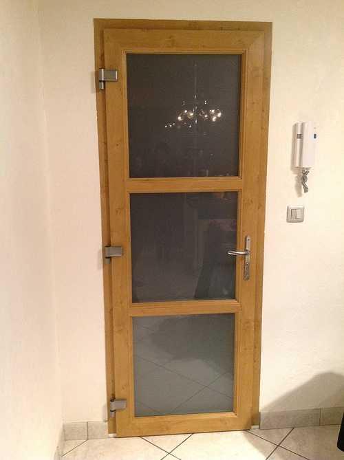 Porte de service isolante PVC chêne clair imitation bois - Tonquedec 0