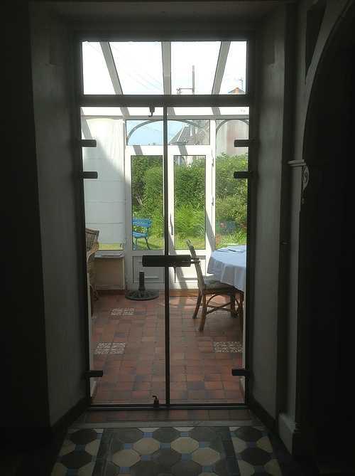 Sas double porte vitrée cadre alu sur véranda - Trébeurden 0