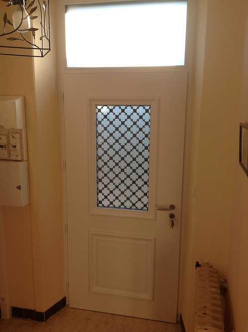 Porte d''entrée alu bi couleur avec grille fer forgé - Pedernec 1122